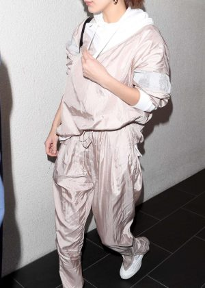 Bella Hadid - Arriving at LAX in a light pink jump suit