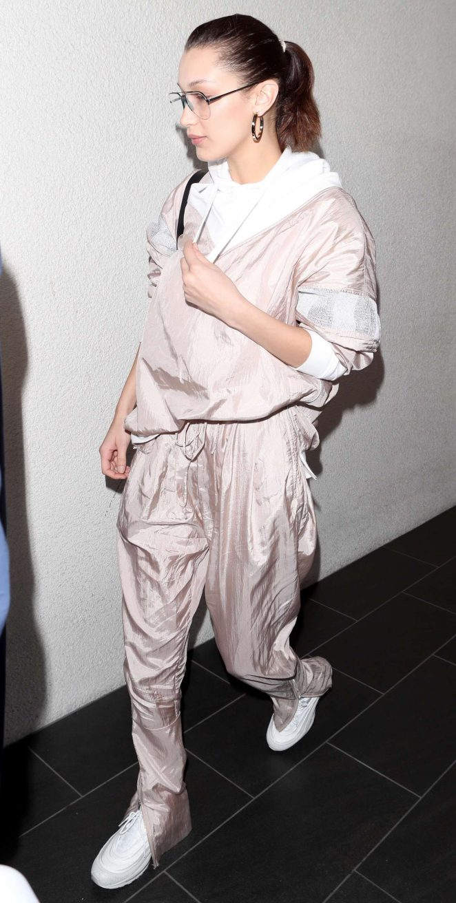 Bella Hadid – Arriving at LAX in a light pink jump suit
