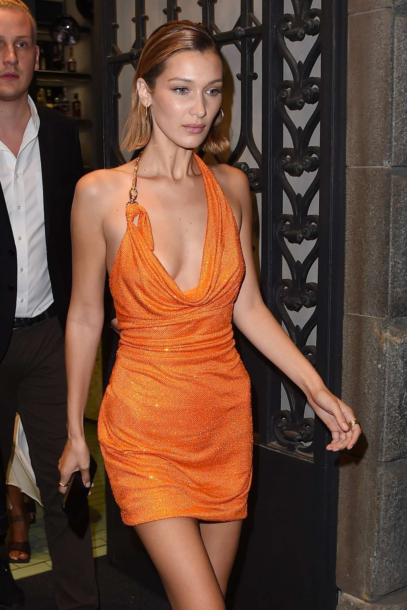 Bella Hadid in Orange Mini Dress at Versace Fashion Show After Party in Milan