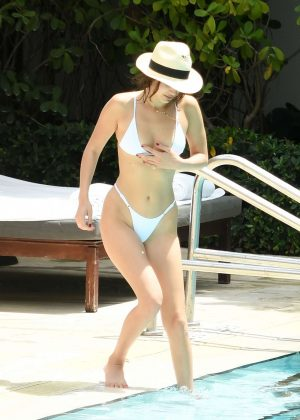 Bella Hadid in White Bikini at a pool in Miami