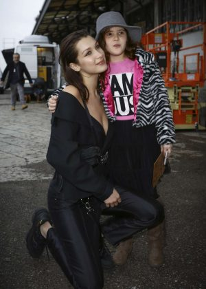 Bella Hadid meets a little fan after the fashion show in Milan