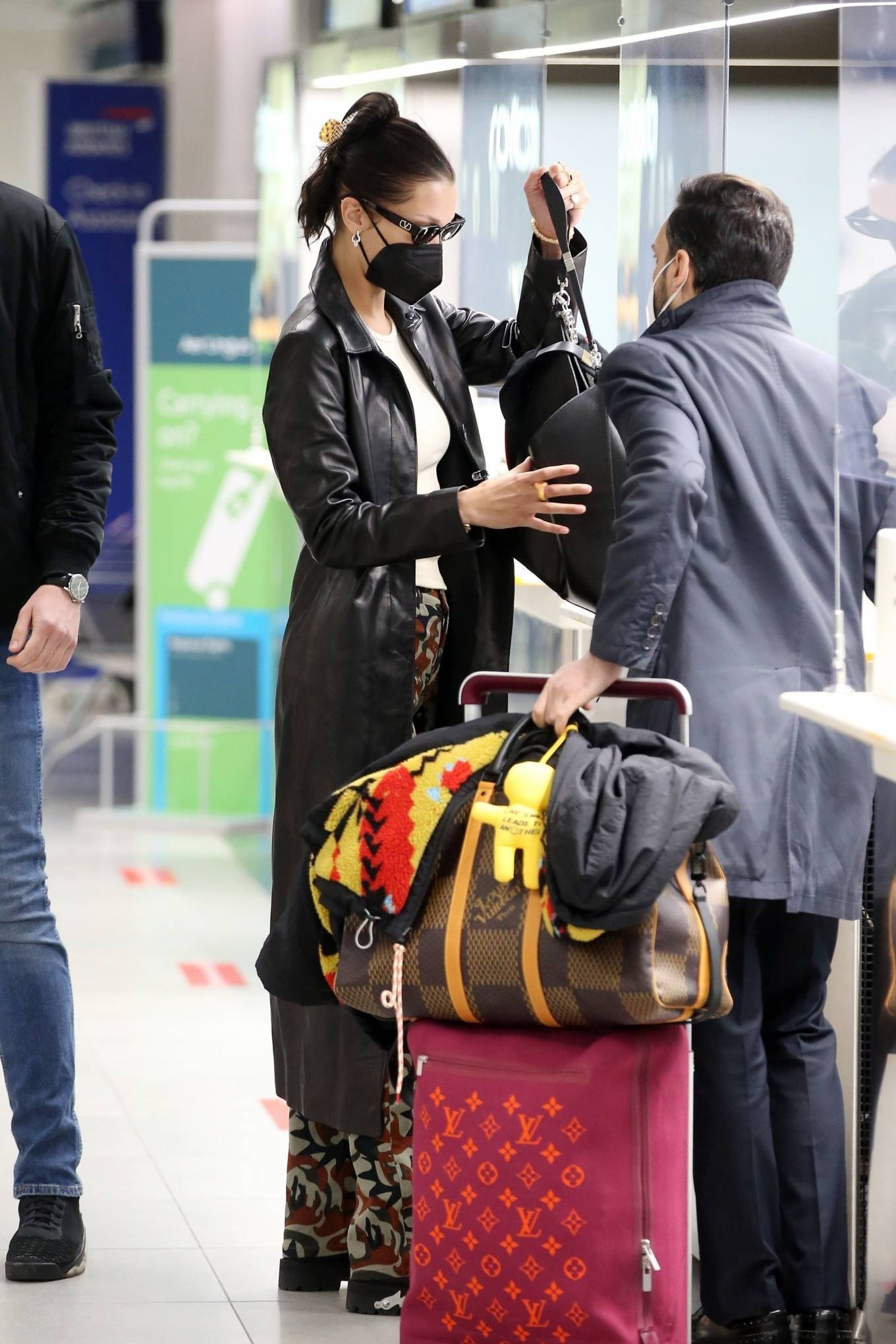 Bella Hadid 2021 : Bella Hadid – Pictured with her bodyguard while leaving her hotel and jetting off from Milan-01