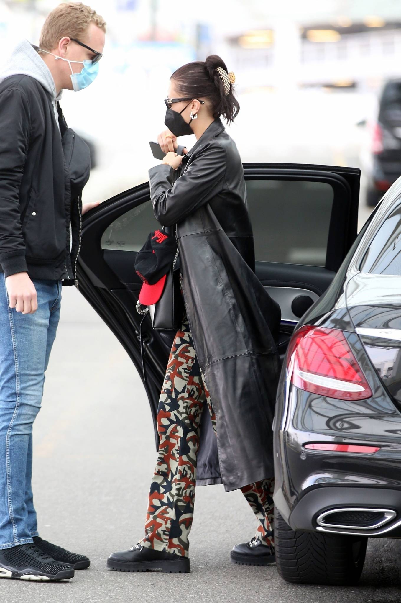 Bella Hadid 2021 : Bella Hadid – Pictured with her bodyguard while leaving her hotel and jetting off from Milan-05