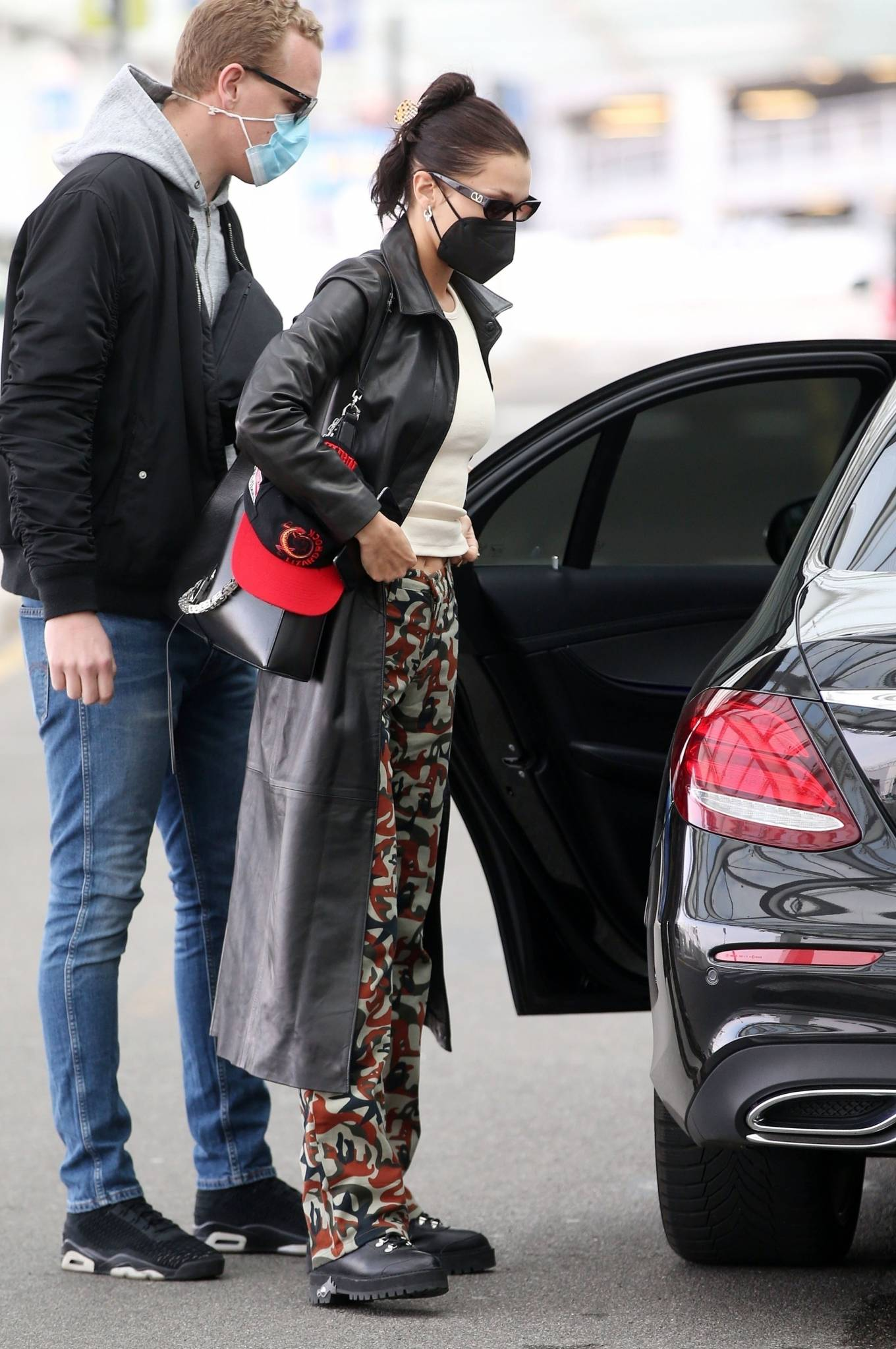 Bella Hadid 2021 : Bella Hadid – Pictured with her bodyguard while leaving her hotel and jetting off from Milan-06