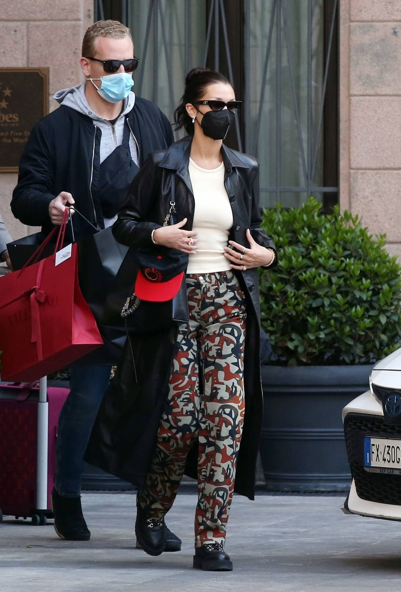 Bella Hadid 2021 : Bella Hadid – Pictured with her bodyguard while leaving her hotel and jetting off from Milan-10