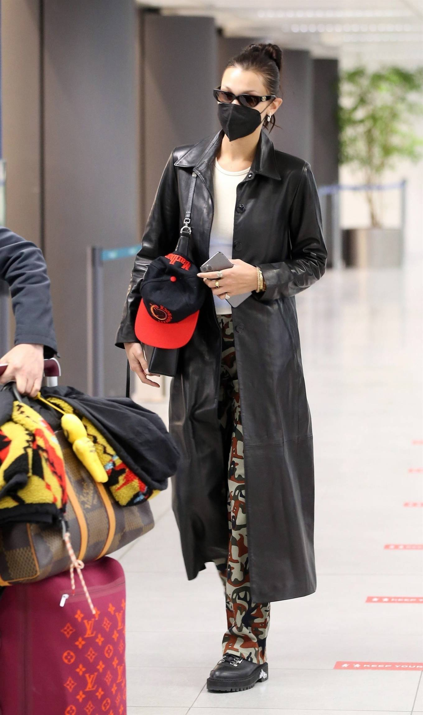 Bella Hadid 2021 : Bella Hadid – Pictured with her bodyguard while leaving her hotel and jetting off from Milan-12