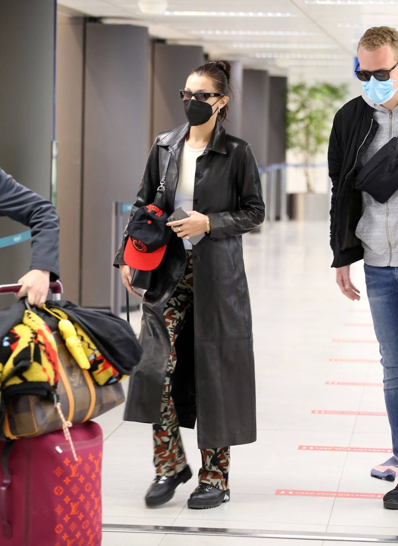 Bella Hadid 2021 : Bella Hadid – Pictured with her bodyguard while leaving her hotel and jetting off from Milan-14