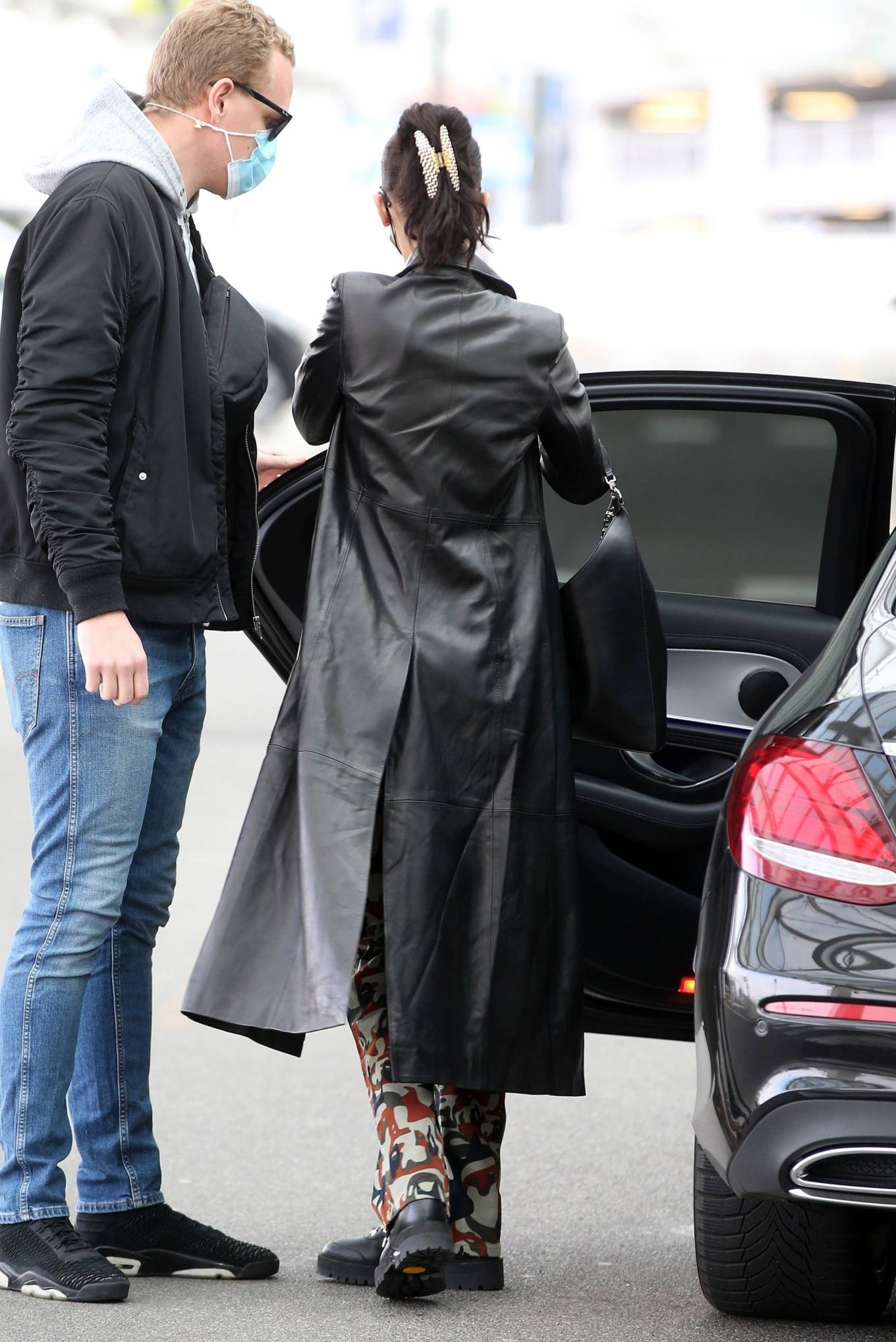 Bella Hadid 2021 : Bella Hadid – Pictured with her bodyguard while leaving her hotel and jetting off from Milan-15