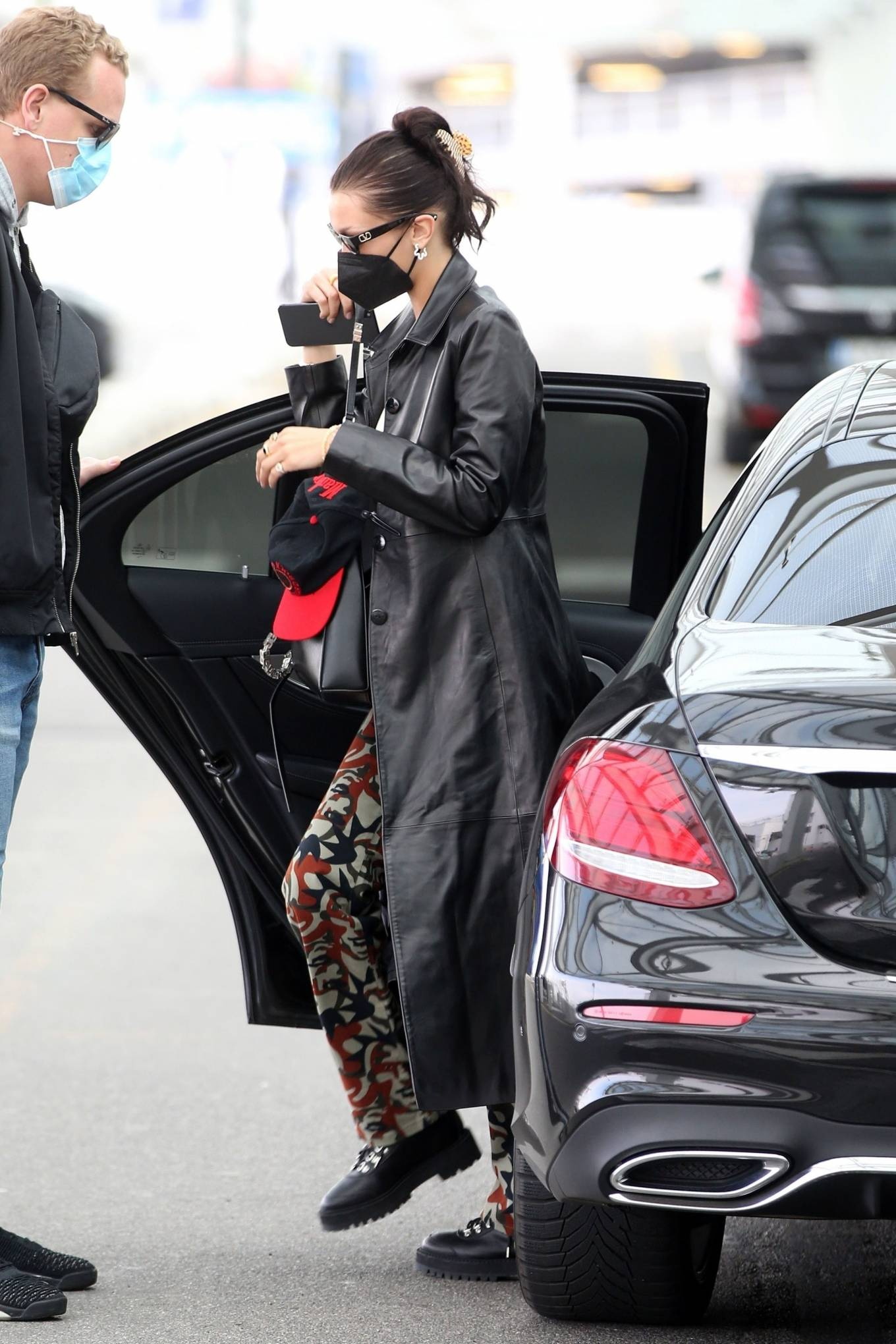 Bella Hadid 2021 : Bella Hadid – Pictured with her bodyguard while leaving her hotel and jetting off from Milan-18