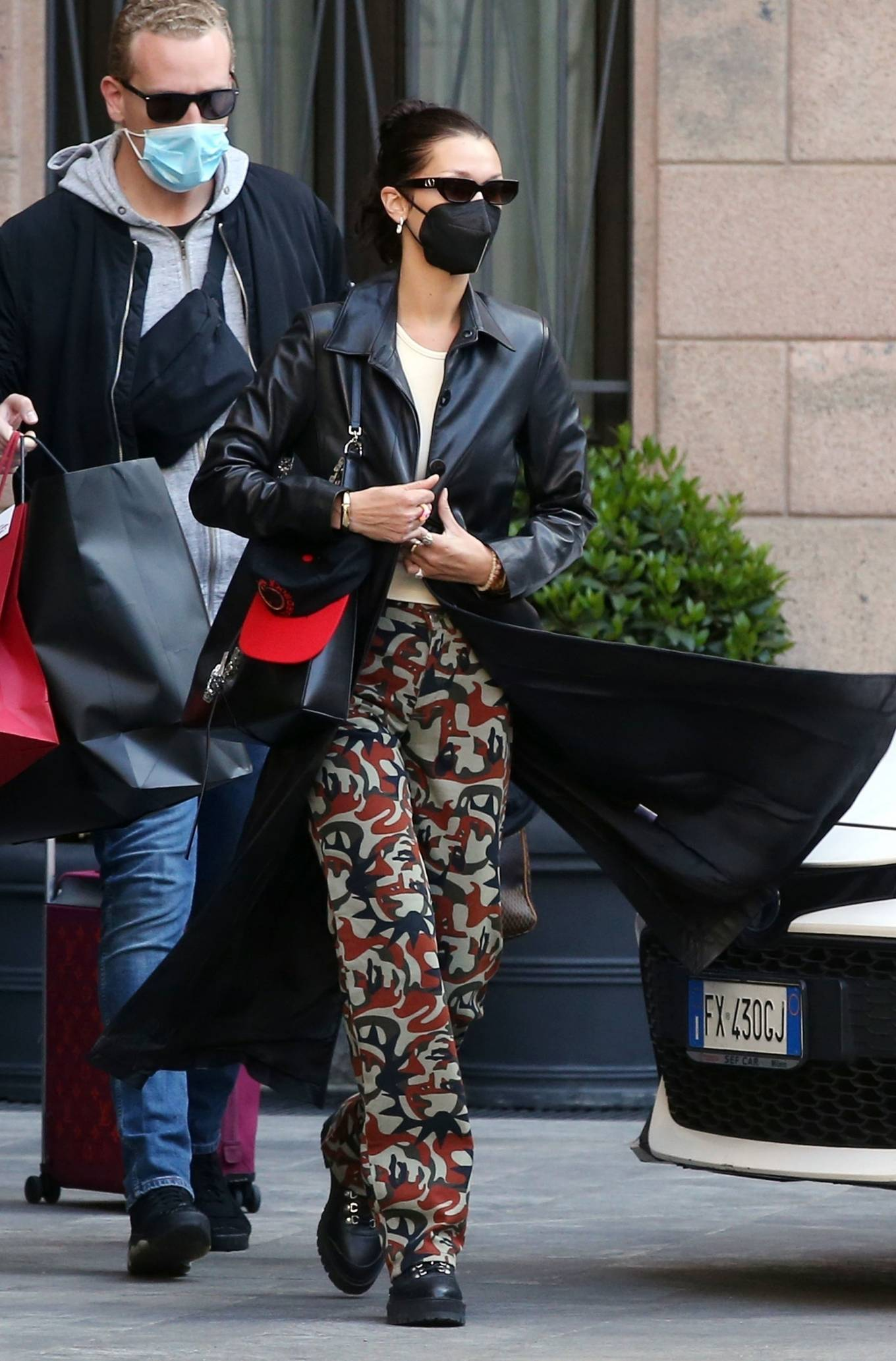 Bella Hadid 2021 : Bella Hadid – Pictured with her bodyguard while leaving her hotel and jetting off from Milan-23