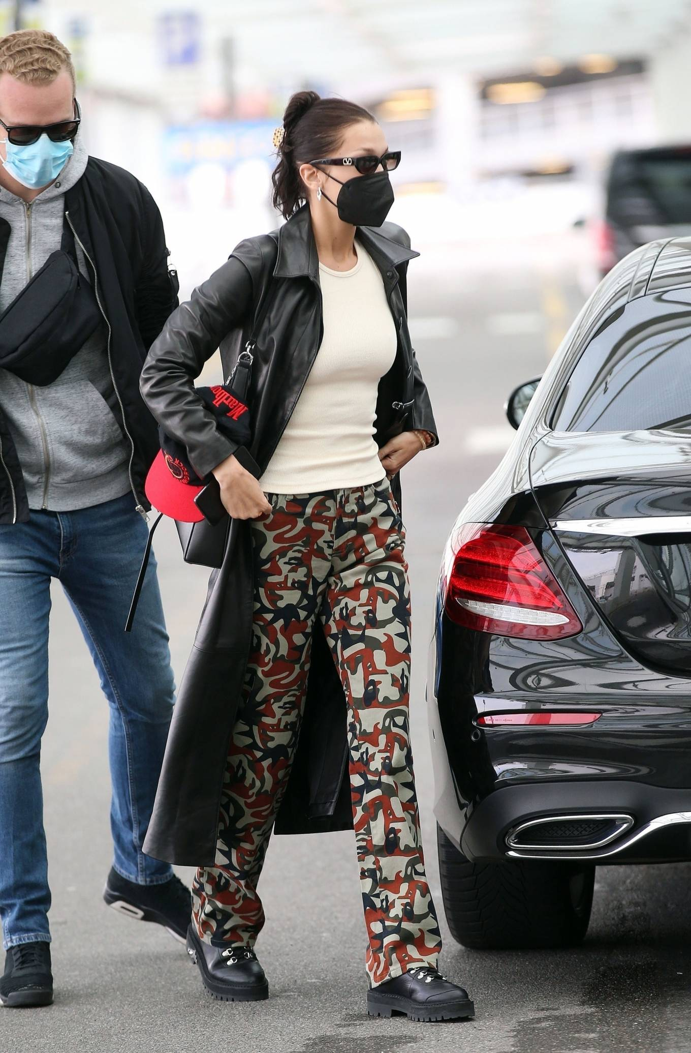 Bella Hadid 2021 : Bella Hadid – Pictured with her bodyguard while leaving her hotel and jetting off from Milan-24