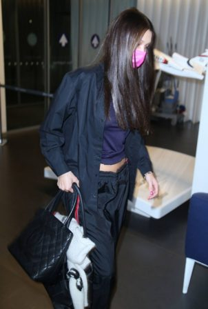 Bella Hadid - Seen as she jets off from Milan