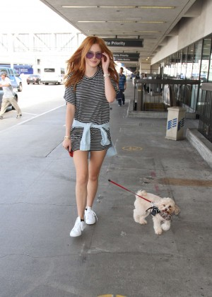 Bella Thorne Leggy in Mini Dress at LAX -01