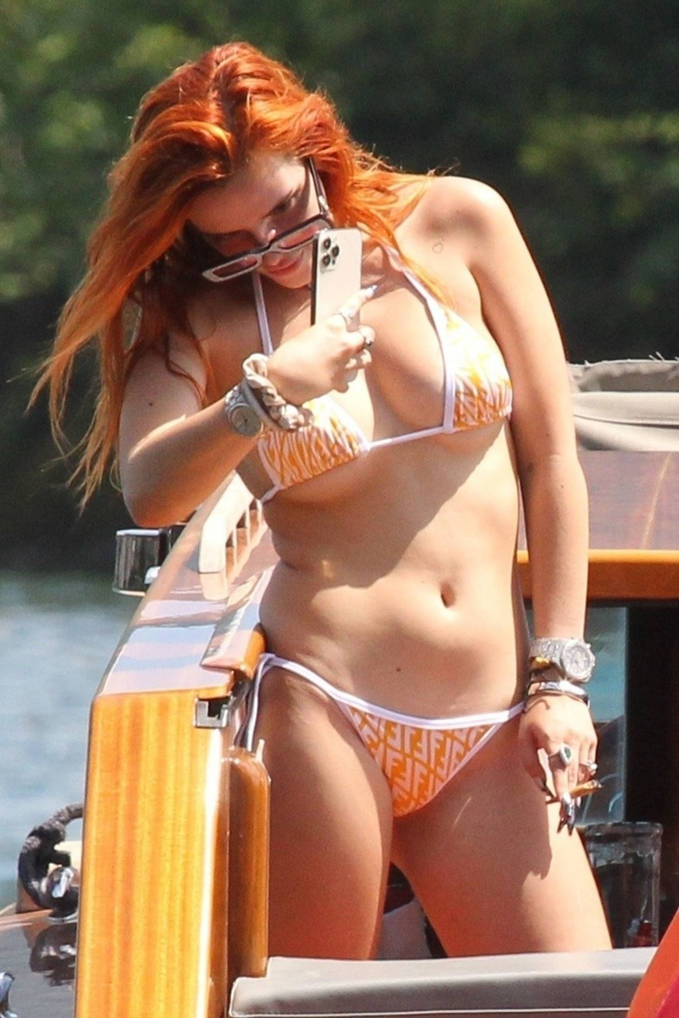 Bella Thorne - Boating in lake Como with her sister Kaili Thorne and friends