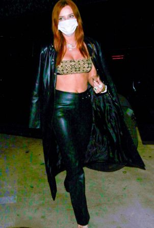 Bella Thorne - In a trench coat arriving to her manager's birthday bash in Hollywood