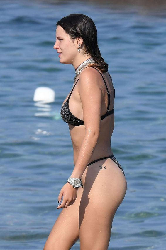 Bella Thorne - In black bikini on the beach in Sardinia