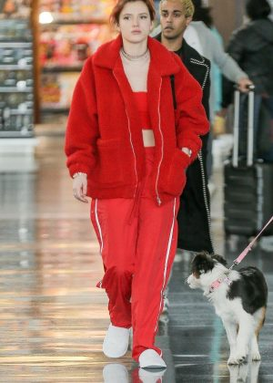 Bella Thorne in Red - Arrives at JFK Airport in New York