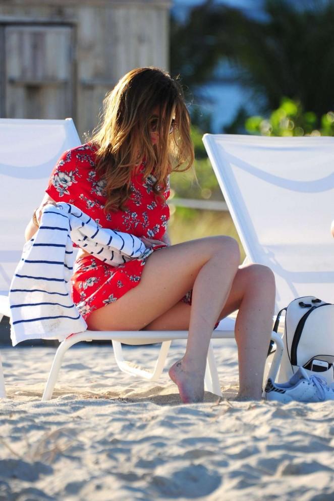 Bella Thorne in Red Mini Skirt at a Beach in Miami