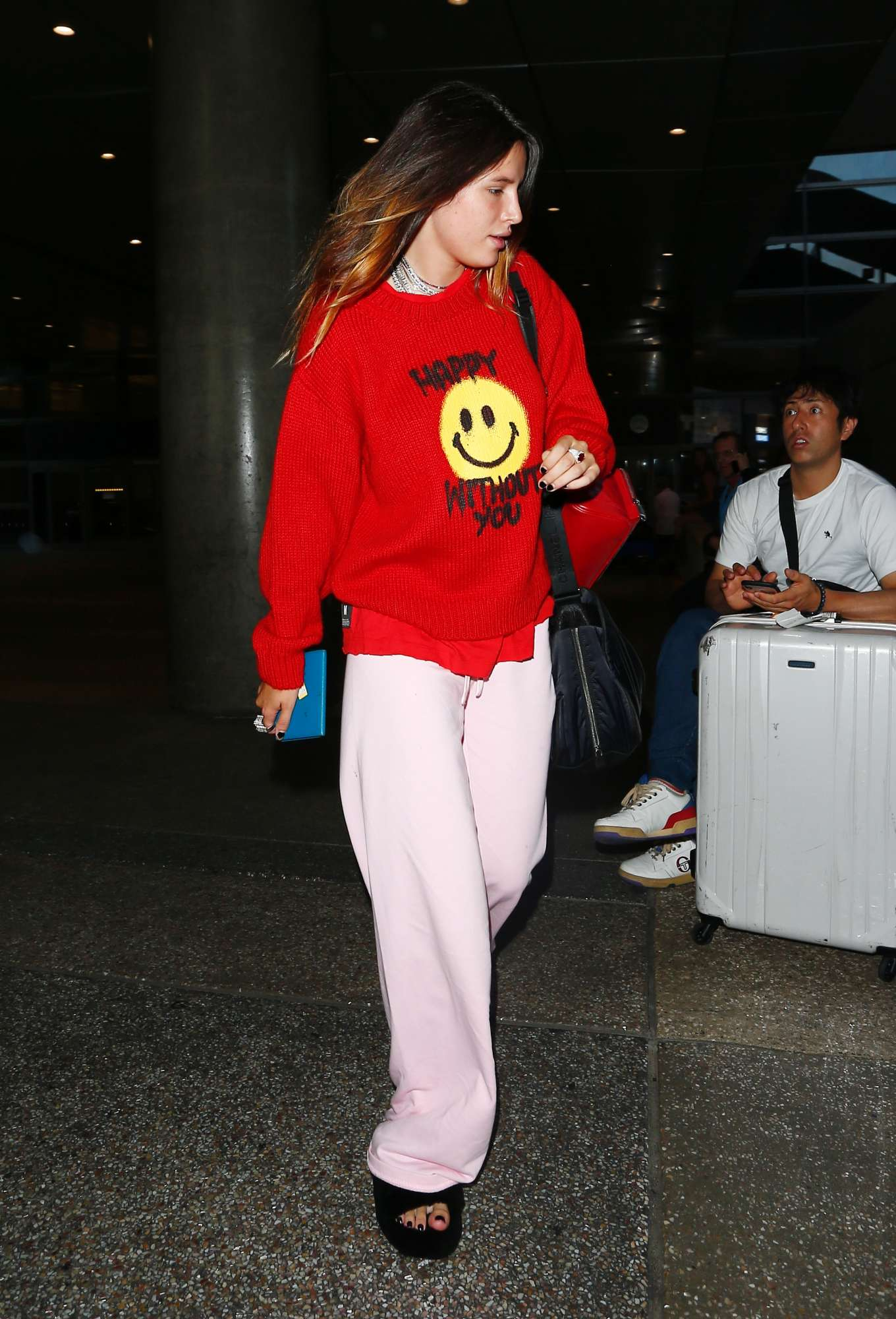 Bella Thorne - Spotted makeup free at LAX