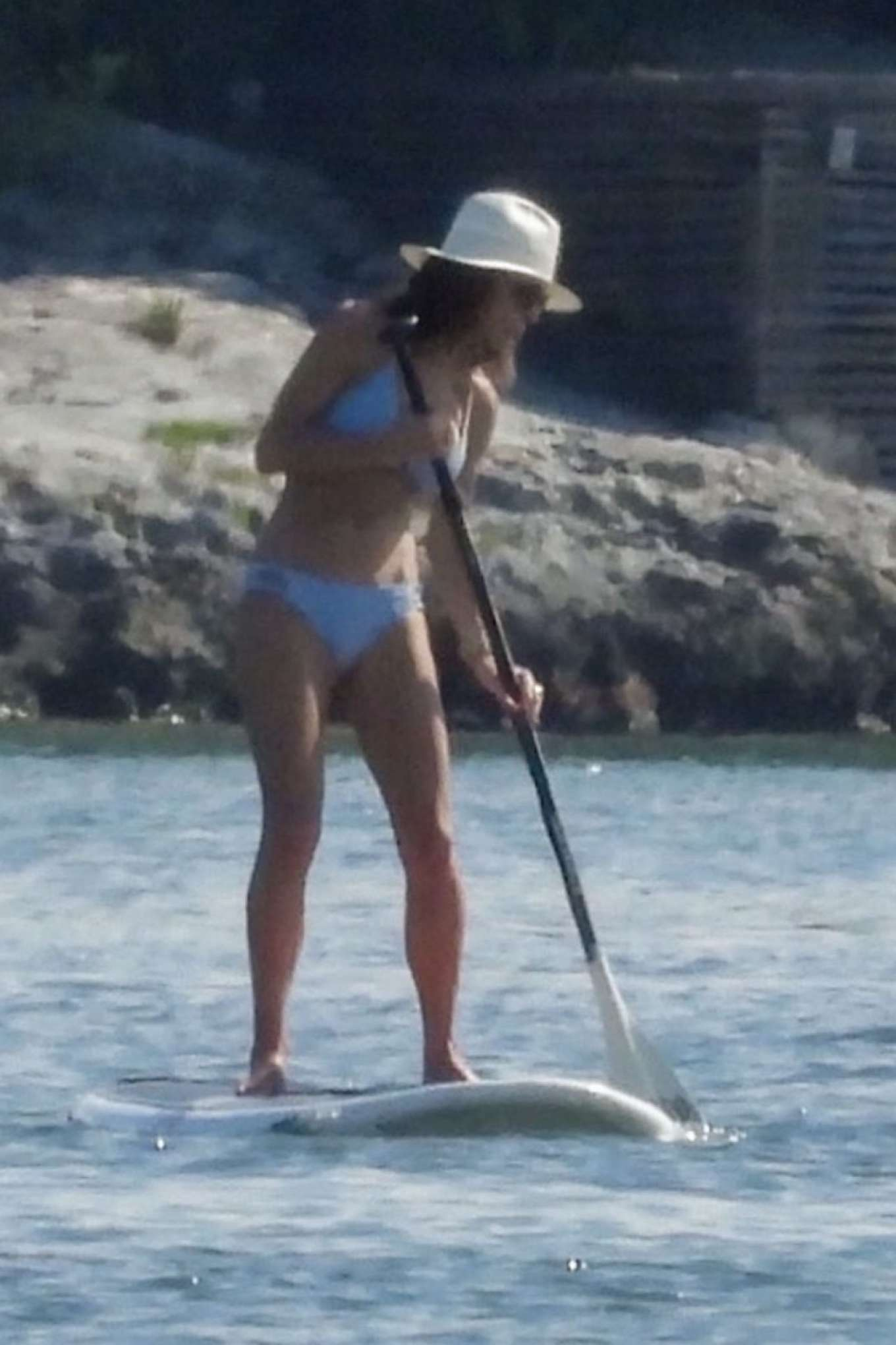 Bethenny Frankel in Bikini Paddleboarding at a beach in Cancun