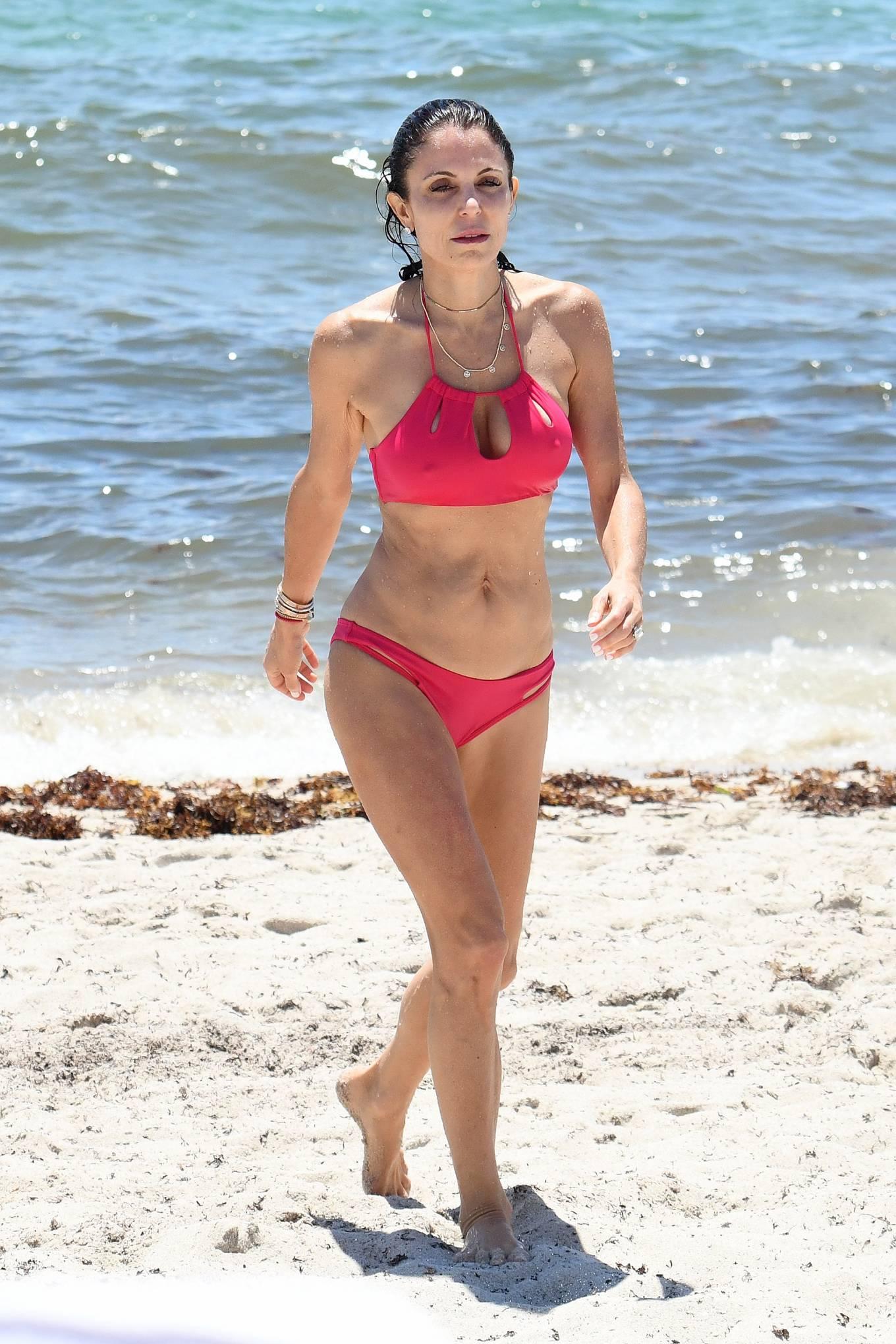 Bethenny Frankel - In pink bikini hits the beach in Miami