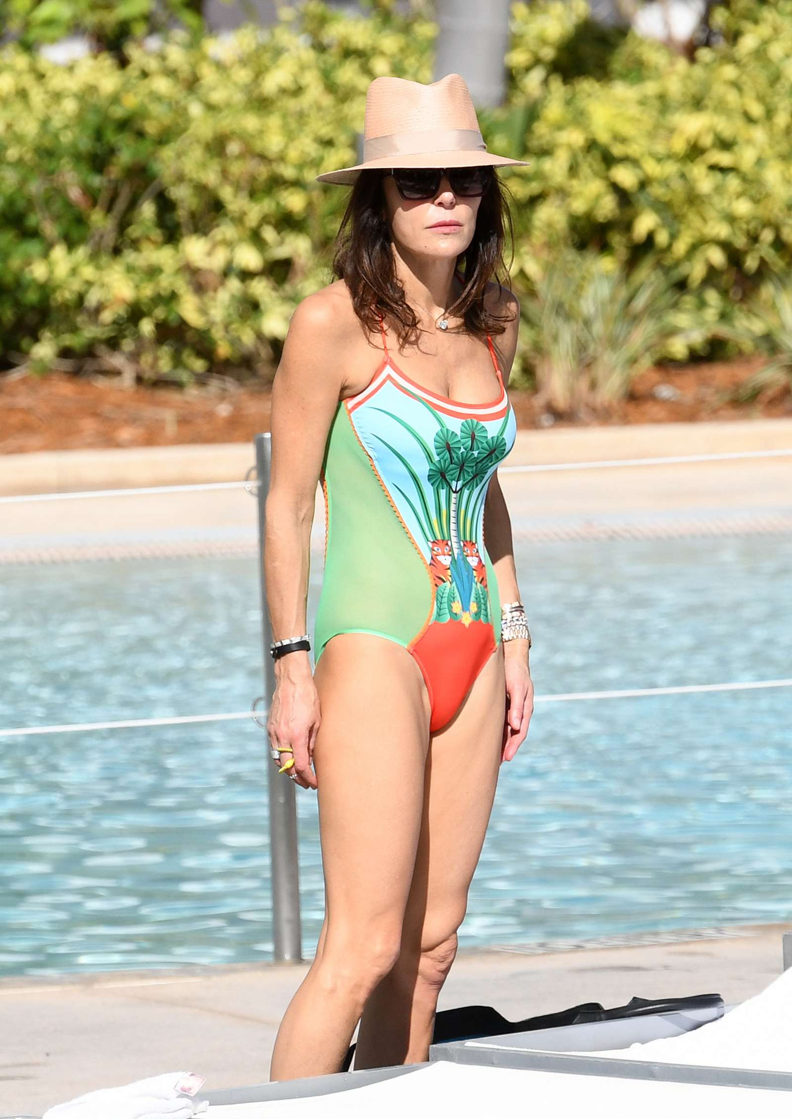 Bethenny Frankel in Swimsuit by the pool in Miami