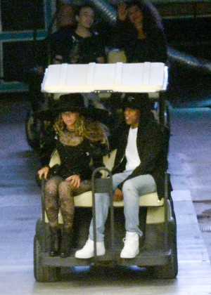 Beyonce and Jay-Z ride together on a golf cart in Miami