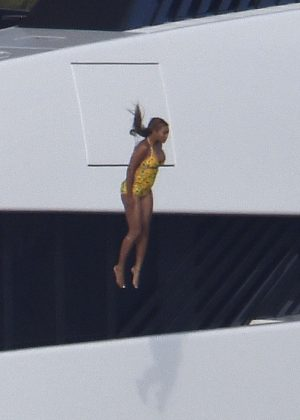 Beyonce in Swimsuit Jumps out of boat in Porto Cervo