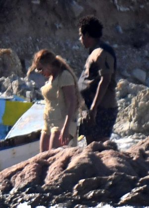 56185a44717 Beyonce  Wearing a tan romper in Sardinia -15 – GotCeleb