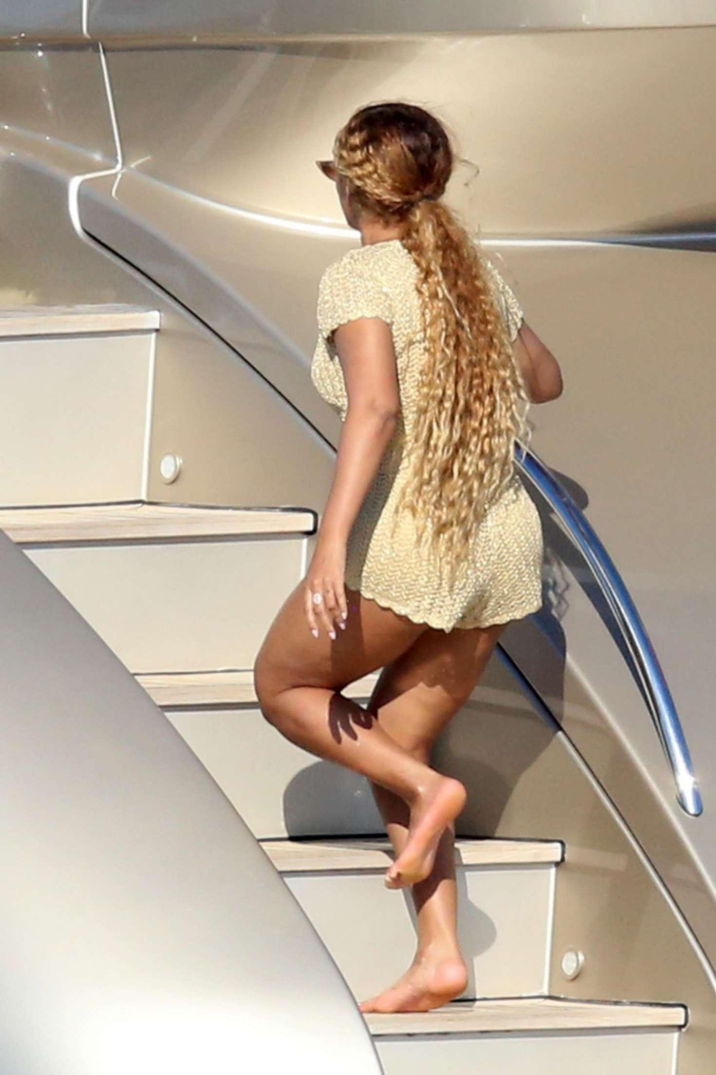 9c759d1a952 Beyonce  Wearing a tan romper in Sardinia -12 – GotCeleb