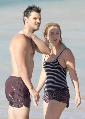 Billie Lourd and Taylor Lautner on the beach in St. Barts