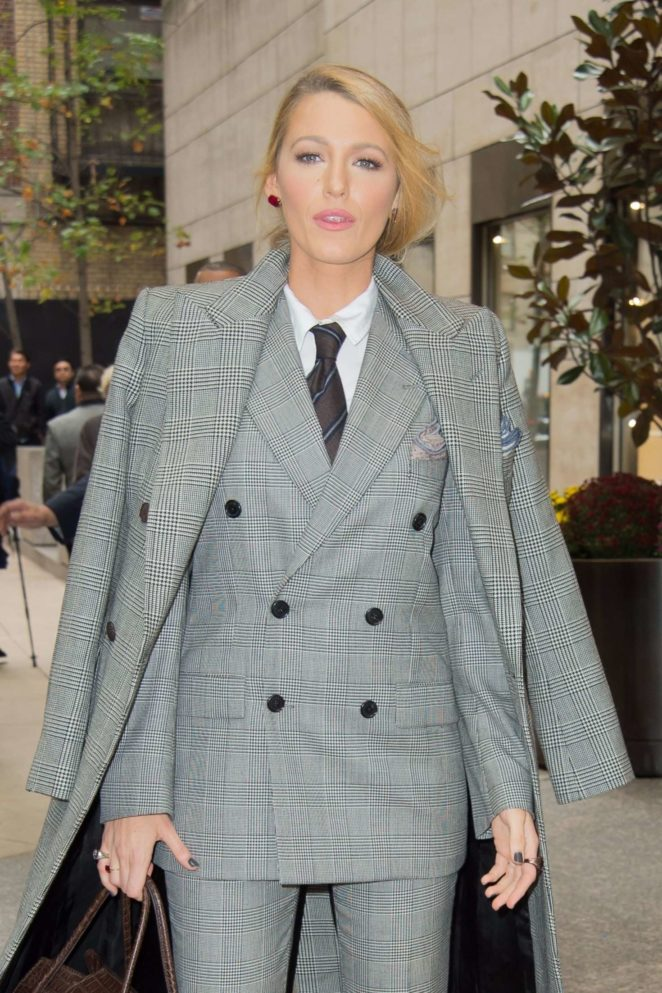 Blake Lively in a black and white pants suit leaves her hotel in NYC