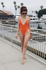 Blanca Blanco in Orange Swimsuit while riding a scooter in Los Angeles