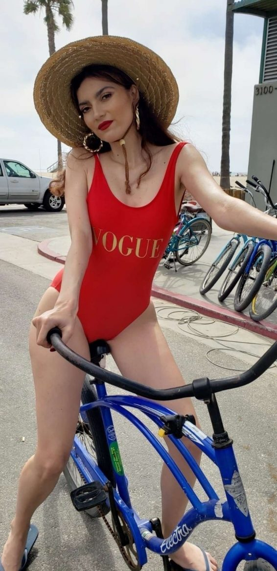 Blanca Blanco in Red Swimsuit - Rides her bike in Venice Beach