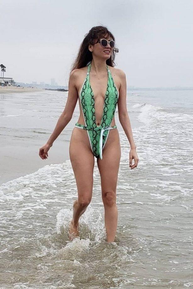 Blanca Blanco in Snakeskin Print Swimsuit at a beach in Malibu