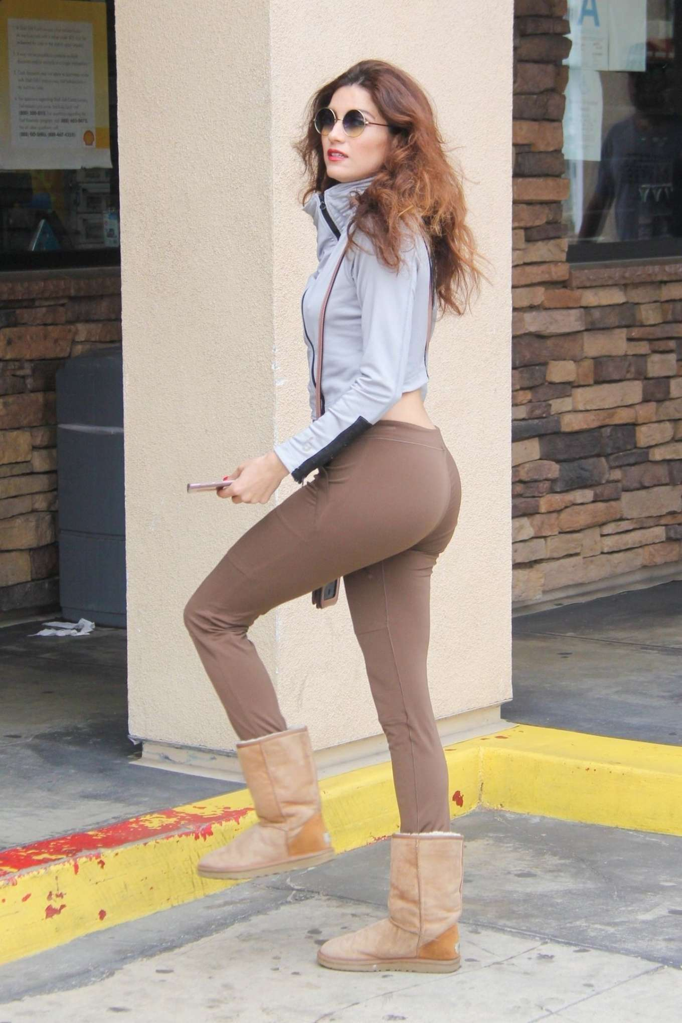 Blanca Blanco in Tights at a gas station in Malibu