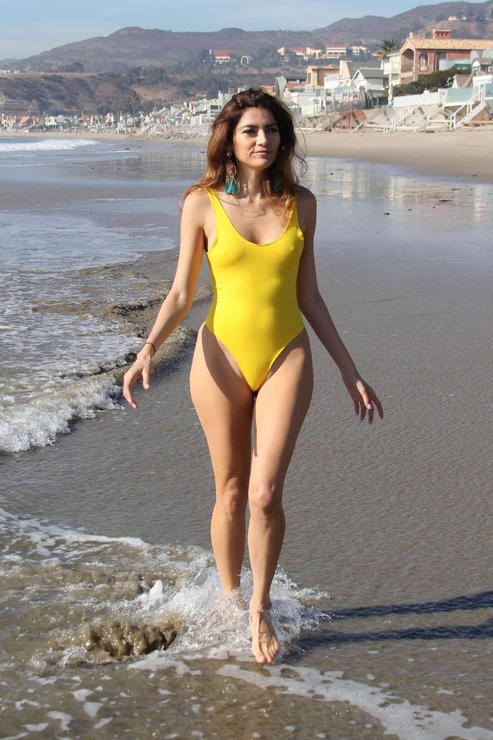 Blanca Blanco in Yellow Swimsuit on the beach in Malibu
