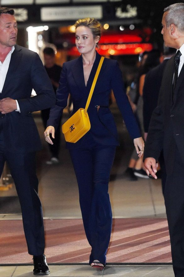 Brie Larson in a navy pantsuit out in New York