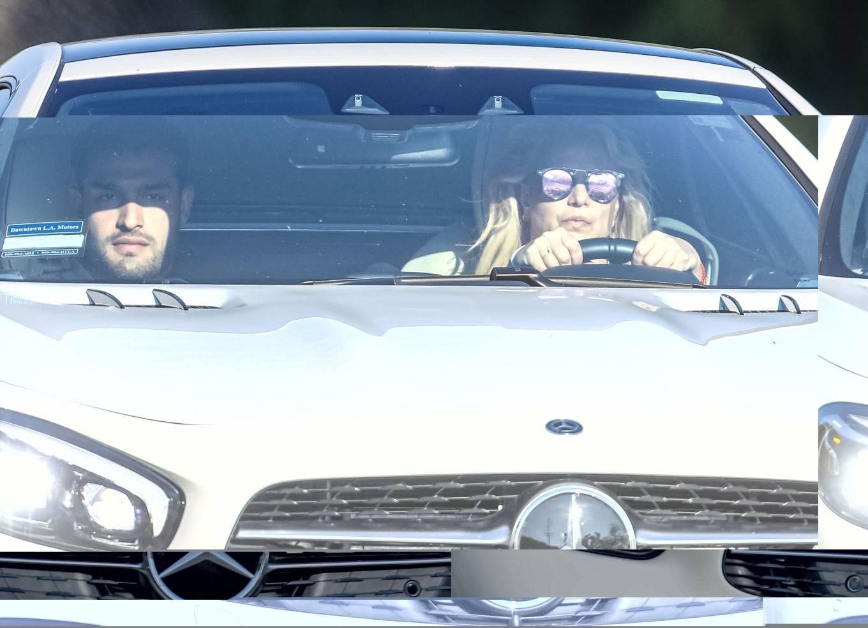 Britney Spears - Seen driving her sportscar with boyfriend Sam Asghari in Westgate