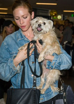 Brittany Snow with her dog at LAX airport in Los Angeles