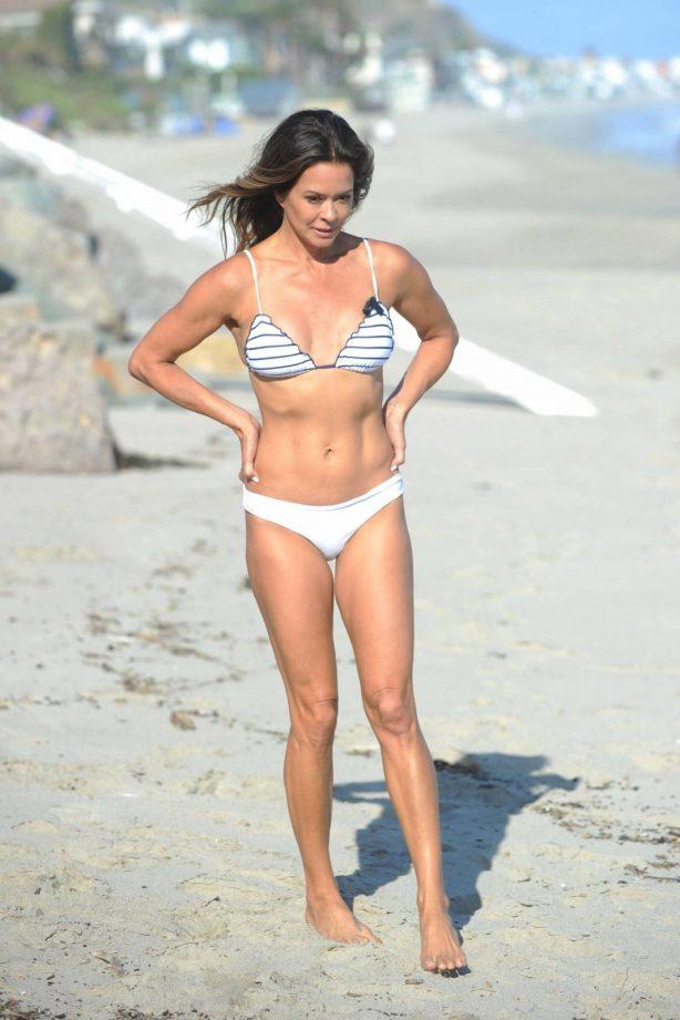 Brooke Burke - In bikini filming Her Body App at a Beach in Malibu