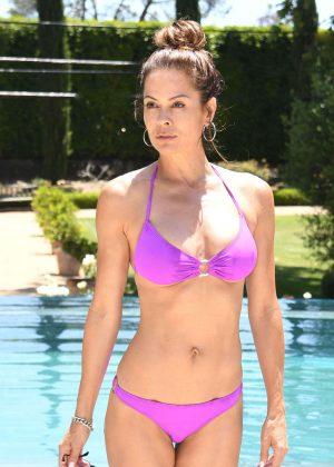 Brooke Burke in Purple Bikini at the pool in Malibu