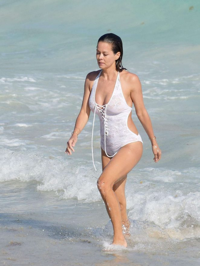 Brooke Burke in White Swimsuit on the beach of St. Barths