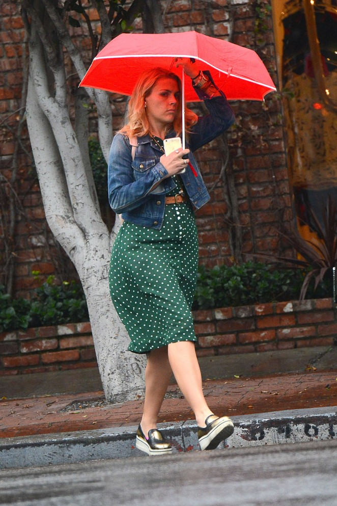 Busy Philipps with red umbrella out in Los Angeles
