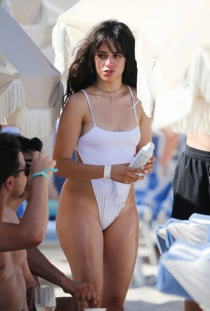 Camila Cabello - Wearing in white bikini hits the beach in Miami