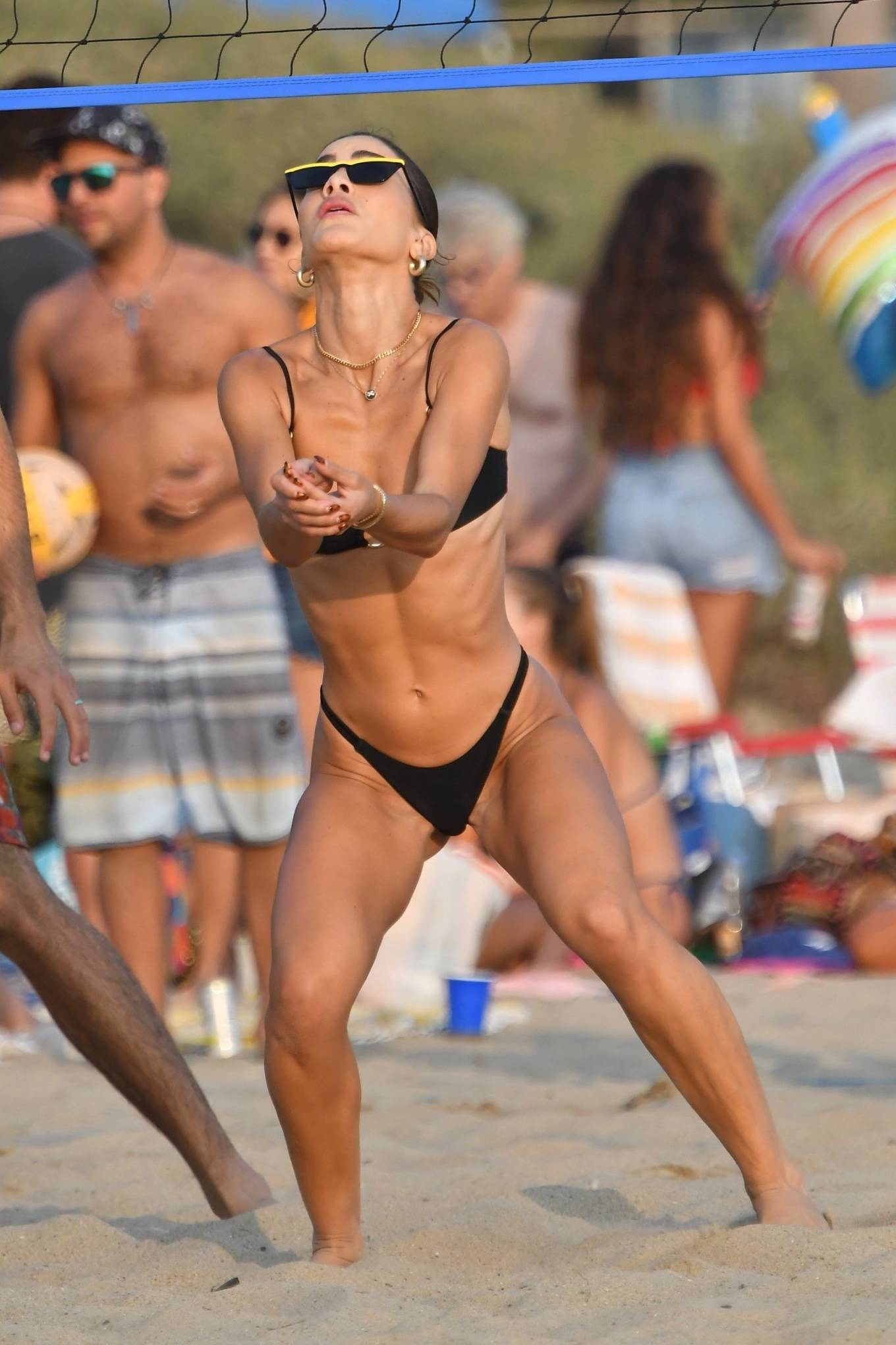 Camila Coelho - In black bikini playing volleyball on the beach in Santa Monica