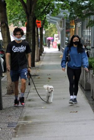 Camila Mendes - heads out with boyfriend Charles Melton for a rainy walk in Vancouver