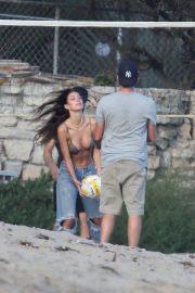 Camila Morrone and Leonardo DiCaprio play volleyball on the beach in Malibu