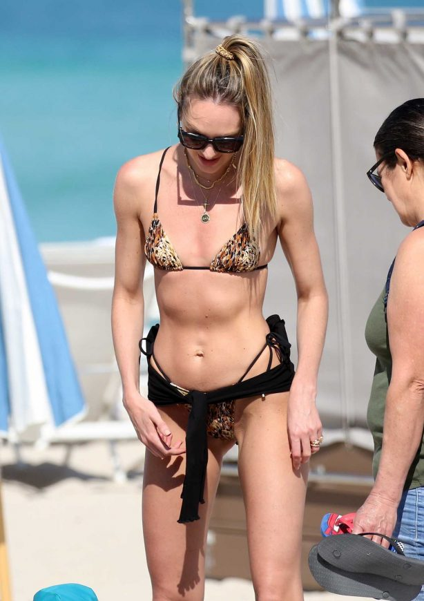 Candice Swanepoel in Animal Print Bikini on the beach in Miami