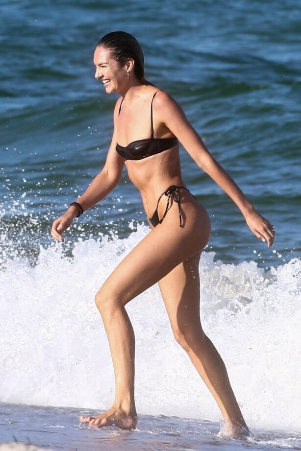 Candice Swanepoel - Seen on the beach in Miami